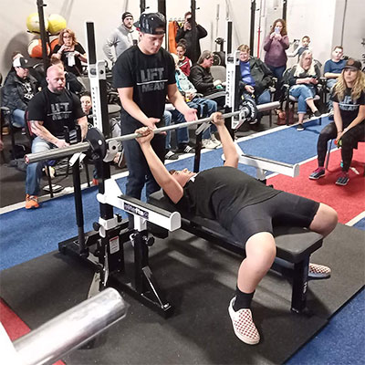 What is the world record for bench press?
